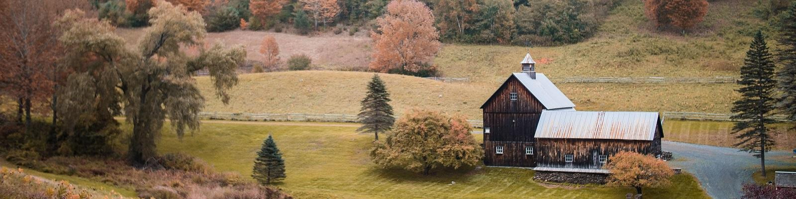 Farmhouse amid rolling hills in Vermont, US