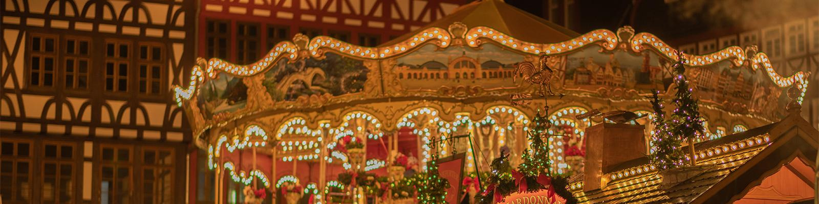 Carousel and Christmas decorations in old European square