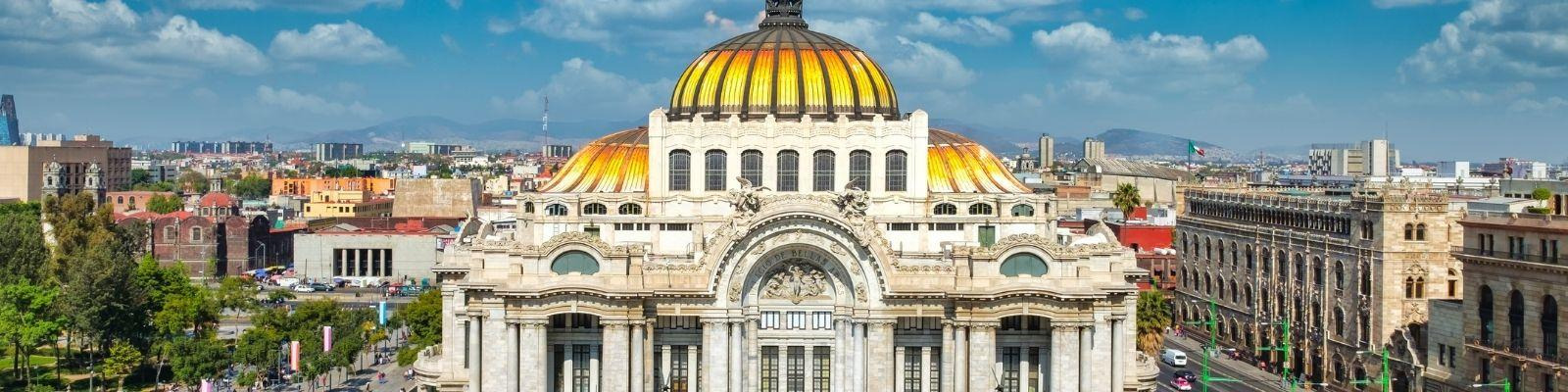 People rush past the Palace of Fine Arts in Mexico City.