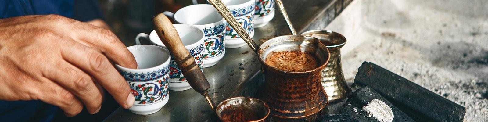 A person brews Turkish coffee in Istanbul. Photo: franz12 / Shutterstock