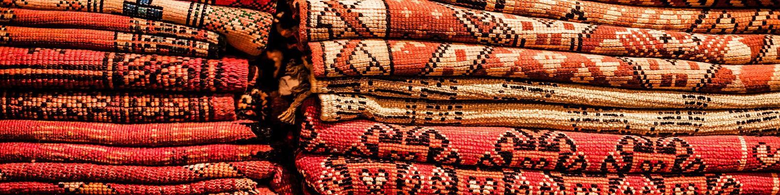 Berber rugs line a street in Marrakech's medina. Photo: streetflash / Shutterstock