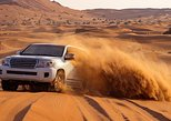 Abu Dhabi Desert Tour with Camel Ride, Sand Boarding, and BBQ Dinner