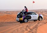 6-Hour Dubai Desert Dinner Safari with Quad Biking and Sandboarding
