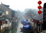 A private tour with Suzhou Jinji Lake and Zhouzhuang Water Town including lunch