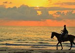 horseback riding SUNSET in the beach