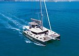 TravelToe Exclusive: Santorini Luxury Catamaran Day Cruise with BBQ and Drinks