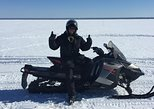 take a tour on a snowmobile from montreal