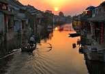 Private Fengjing and Xitang Water Town Sunset Boating Tour with Dinner from Shanghai