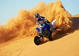 Dubai 30-Minute Desert Quad Bike Ride with Camel Ride, Sand Boarding, and BBQ Dinner