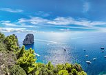 travel to capri by boat and then visit the splendid blue grotto