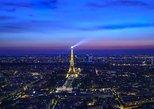 Eiffel's Glittering Tower's Summit by Night
