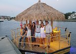 A Charleston Harbor tour on a polynesian style real bamboo motorized tiki bar.