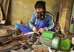 Discover knife Da Sy village by motorbike