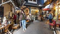 Shoppers at the historic Saint-Ouen Flea Market in Paris, France