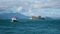 Photo of a boat from Alcatraz Cruises departing Alcatraz Island in the San Francisco Bay Area