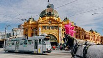 Tram passes Flinders Street Railway Station in Melbourne, Australia