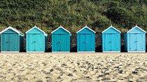 Beach huts on Bournemouth Beach, England.