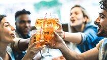Friends cheers over Aperol Spritz cocktails