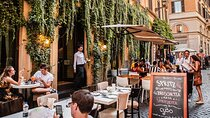 An outdoor restaurant patio on a side street in Rome