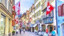 Shoppers walk down a street in Zurich