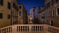 A night view of canals and calli in Venice, Italy