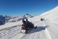 Dolomites Day Trip with snowmobile experience