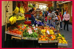 Local market visit and dining experience at a Cesarina's home in Sorrento