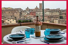 Dining experience at a Cesarina's home in Siena with show cooking