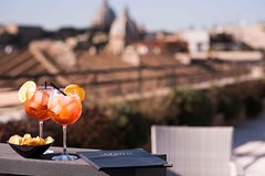 Sunset drinks on the rooftops of Rome