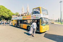 Imagen Recorrido en autobús con paradas libres y crucero por el río en Lisboa