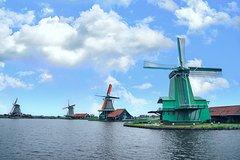 Escape the city crowds and dive into the scenic Dutch countryside-private