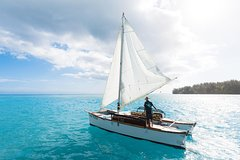 Excursion and initiation to traditional sailing with a homemade double canoe.
