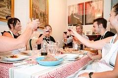 Dining experience at a locals home in Rome with show cooking