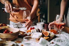 Professional 6 Wines Tasting with Regional Appetizers in a Local's home -