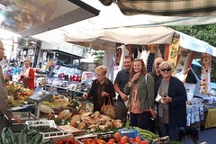 Local market visit and dining experience at a locals home in Siena