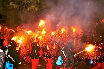 Experience Catalonia: Correfoc Fire Running Festival Experience from Barcelona