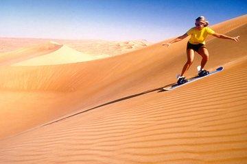 Dubai Desert Morning Tour Camel Ride, Quad Bike Tour, Sand boarding, and Camel Farm