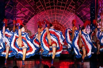 Dinner show at the Moulin Rouge with transport and night tour