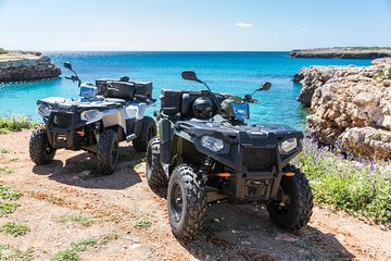 Quad sightseeing tour with a visit to the caves of Arta-passenger