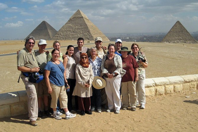 Group Tour to Giza pyramids sphinx camel ride from Le Meridian pyramids Hotel