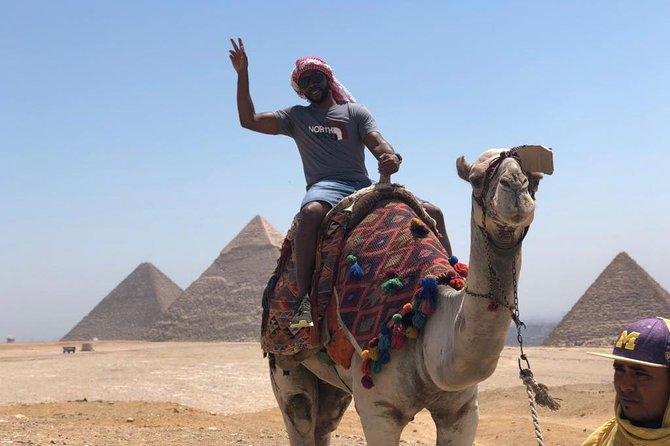 5 hours Experience to Giza pyramids sphinx plus camel cruise lunch on Nile photo 12