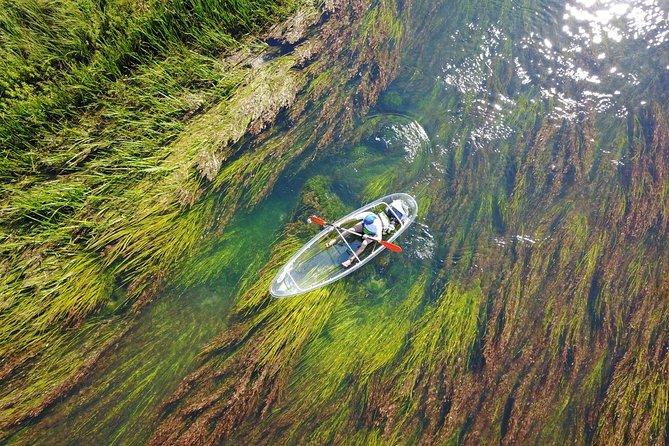 Transparent kayaks on river Gacka