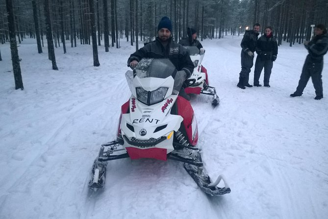 Northern Lights Snowmobile Hunt from Ruka including Campfire Picnic