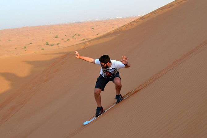 Dubai Morning Quad Bike with Sandboarding and Camel Ride photo 4