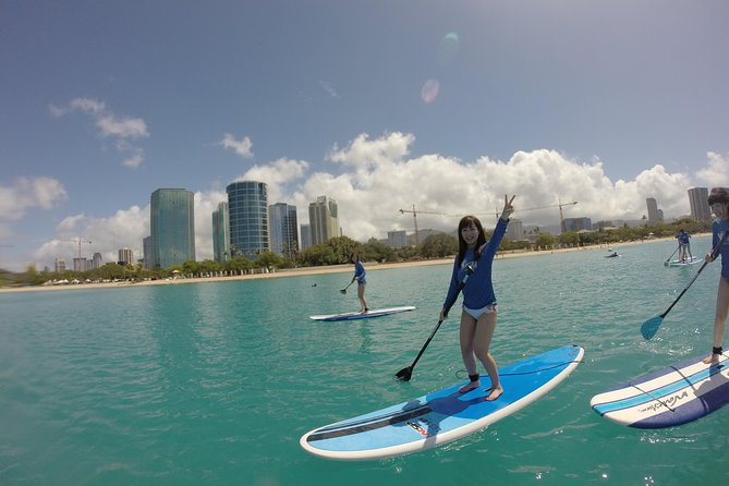 Surf HNL: Ala Moana Stand-up Paddleboard Lesson with Round-trip Transport