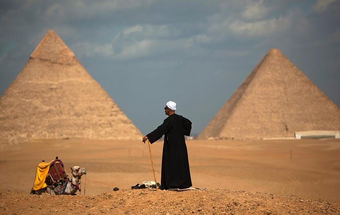Private Guided Half-Day Trip to Giza Pyramids with Camel-Riding