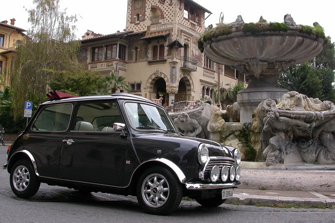 Beautiful neighbourhoods of Rome Tour by Mini Vintage Cabriolet , special drink stopover included