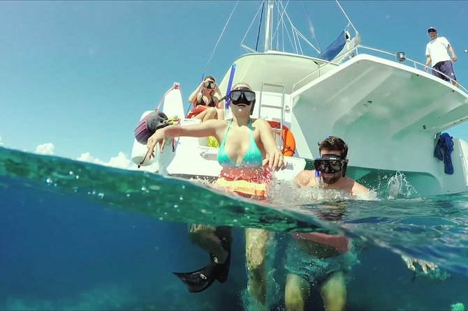 An amazing day of catamaran ride to Isla Mujeres with snorkel photo 2