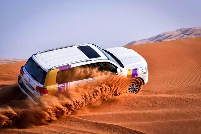 Dubai Desert Safari with BBQ And 4W Land Cruiser Dune Bashing Experience-Sandboarding
