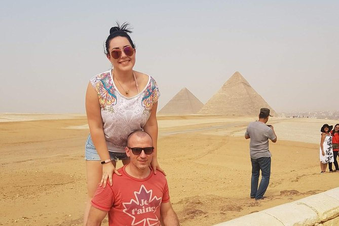 day guided trip to Giza pyramids , Coptic old Cairo ,Saladin citadel and bazaars